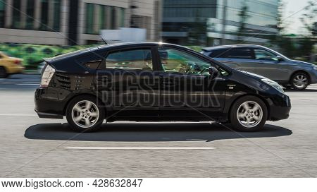 Black Toyota Prius Second Generation Xw20 Car Moving On The Street In Motion. Moscow, Russia - Augus