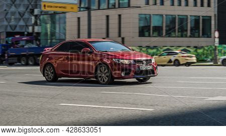 Moscow, Russia - August 2021: Kia Forte Koup First Generation Td In Blurred Motion On A City Street.