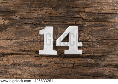 Number Fourteen - White Piece On Rustic Wood Background
