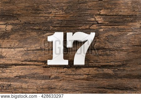 Seventeen 17 - White Wooden Number On Rustic Background