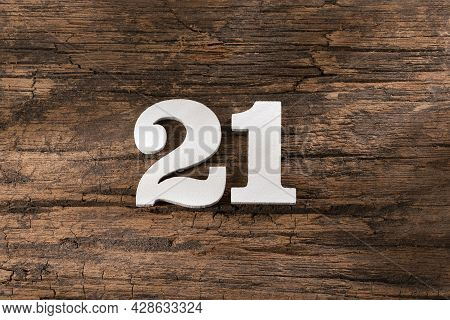 Twenty One 21 - White Wooden Number On Rustic Background
