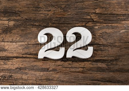 Number Twenty-two 22 - White Piece On Rustic Wood Background