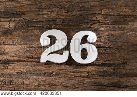 Number Twenty Six 26 - White Piece On Rustic Wood Background