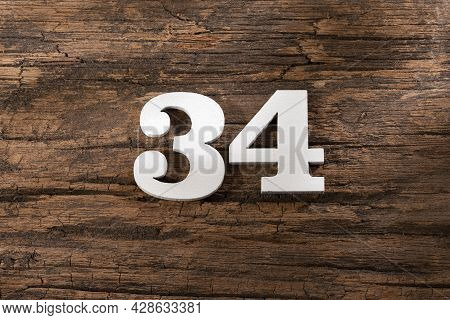 Number Thirty Four 34 - White Piece On Rustic Wood Background
