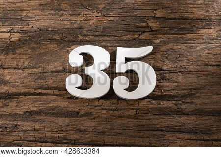Thirty Five 35 - White Wooden Number On Rustic Background