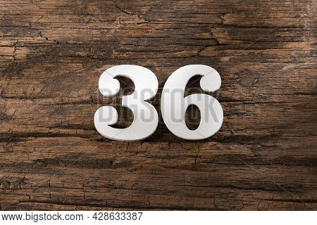 Number Thirty Six 36 - White Piece On Rustic Wood Background