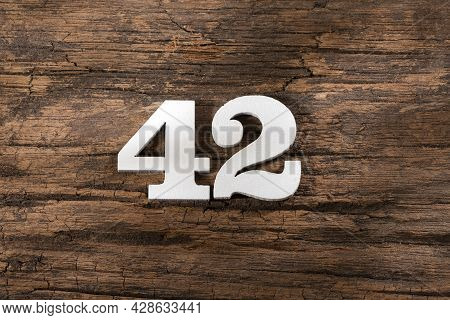 Number Forty Two 42 - White Piece On Rustic Wood Background