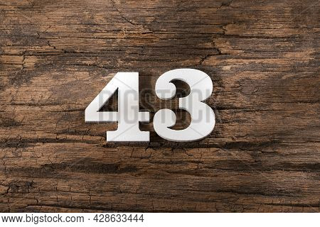 Forty Three 43 - White Wooden Number On Rustic Background