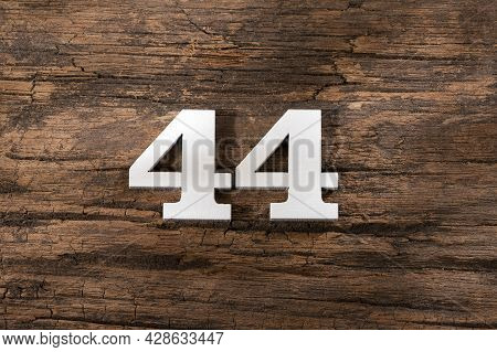 Number Forty Four 44 - White Piece On Rustic Wood Background