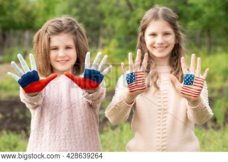 Friendship Of Peoples, Exchange Of Students. Learning Foreign Languages. Child Hands Painted In Amer