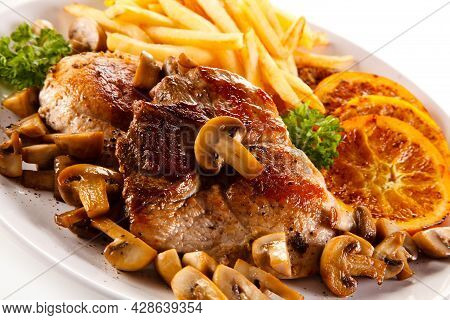 Roast Steak With French Fries High Quality Image
