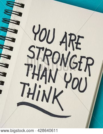 you are stronger than you think, inspiration and motivation concept or reminder - handwriting in a sketchbook