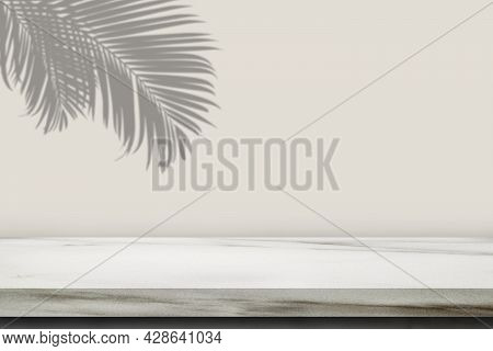 Empty Space Of Marble Shelf With Palm Leaves Shadow Shading On Grey Wall.