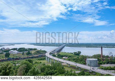 Khabarovsk, Russia, July 8, 2021: Bridge Over The Amur River Summer Landscape