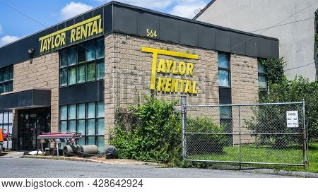 NORWALK, CT, USA - JULY 31, 2021:Taylor Rental building near Post Road in nice summer day