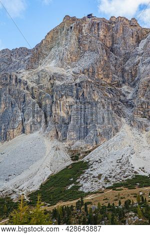White and gray dolomite rocks. The majestic pass in the Eastern Alps of Falzarego. Picturesque sunset in the colorful rocks of the Dolomites. The clouds are flying across the sky