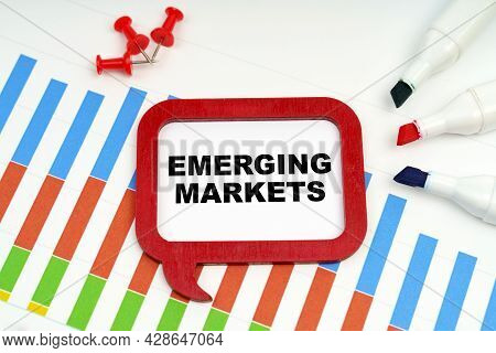 Business And Economy Concept. There Are Markers, Charts And A Sign On The Table - Emerging Markets