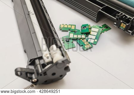 Several, Multiple, A Set Of Different Chips, Microchips Lies On The Table Near The Disassembled Cart