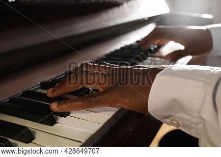 African-american Man Playing Piano, Closeup. Talented Musician