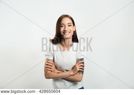 Portrait Of Pretty Young Woman With Gorgeous Chestnut Hair And Charming Smile On Light Background