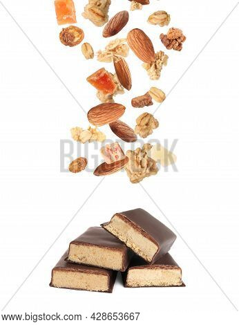 Tasty Chocolate Glazed Protein Bars And Granola With Almonds And Dried Fruits Falling On White Backg