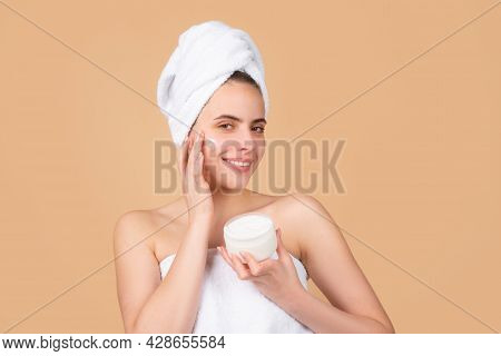 Beauty Woman With Cosmetic Products Clean Healthy Natural Skin. Portrait Of Attractive Young Girl Wi
