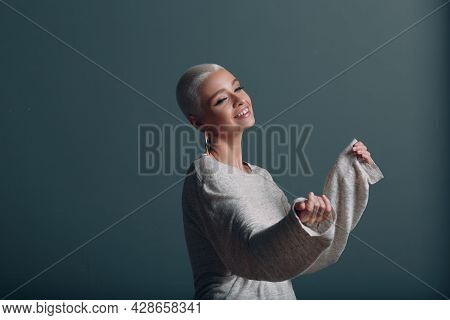Millenial Young Woman With Short Blonde Hair Portrait With Hands Up In The Air Dancing Party