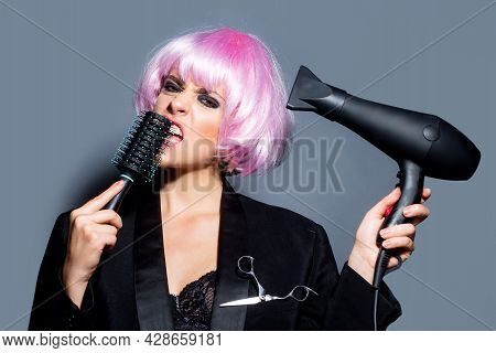 Fashion Woman With Hair Dryer. Beautiful Girl With Straight Hair Drying Hair With Professional Haird