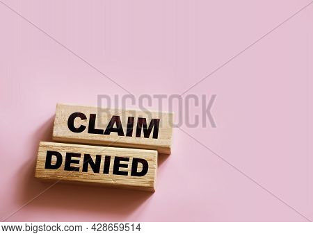Wooden Blocks With The Text: Claim Denied. Insurance Business Concept.