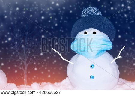 Snowman With Face Protection Mask. Winter Landscape. Merry Christmas And Happy New Year Greeting Car