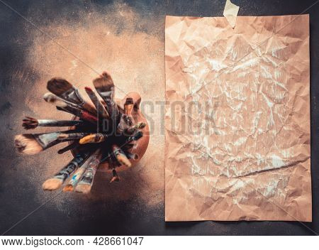 Paint brush as art painter tool on abstract background texture. Paintbrush for painting and piece of paper as artistic paint still life. Abstract art concept
