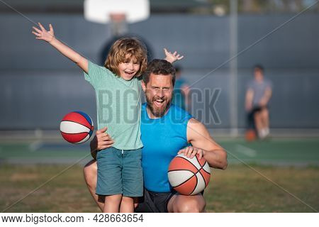 Father And Son Enjoying Sport Basketball Outdoor. Childhood And Parenting Concept. Weekend Sport Man