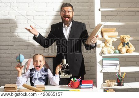 Excited Teacher With Amazed School Girl In School Lesson. Little Student Schooling. Happy Funny Scho