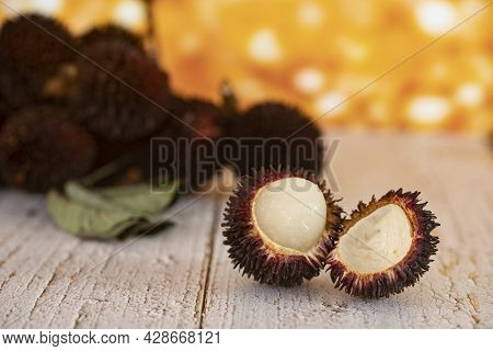 Close-up Of A Peeled Pulasan. Pulasan Is A Tropical Fruit From Soapberry Family, Similar To Rambutan