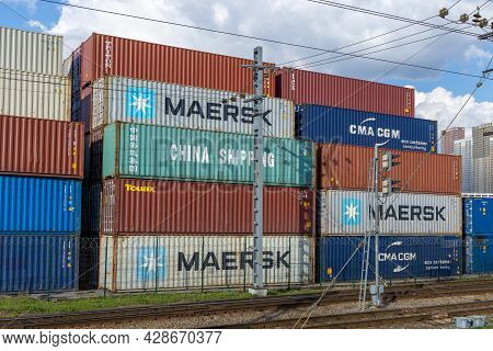 Stacked Cargo Containers Maersk, Cma Cgm And Others In Railway Container Terminal. International Car