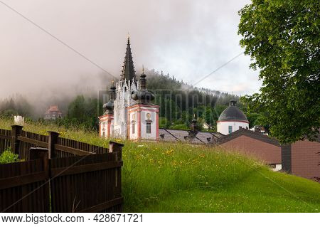 Basilica Of The Birth Of The Virgin Mary In Mariazell (austria), Foggy Morning. This Is The Most Imp