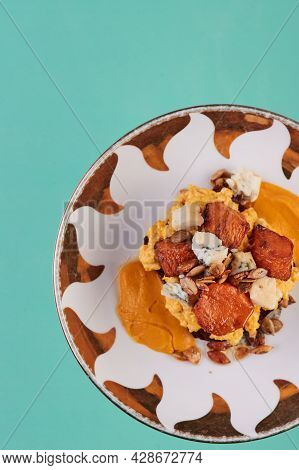 Vegetarian Toast With Scrambled Eggs, Pumpkin, Nuts And Brie. Lenten Dish On A Colored Background. T