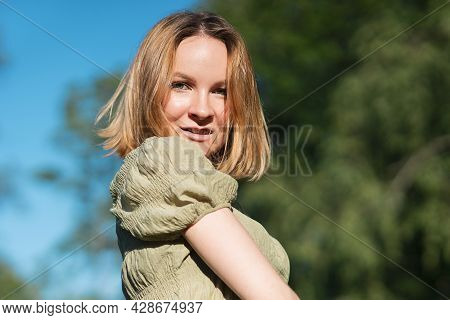 Portrait Of Happy Beautiful Pretty Girl, Young Positive Red Head Woman Walking In Summer Sunny Park
