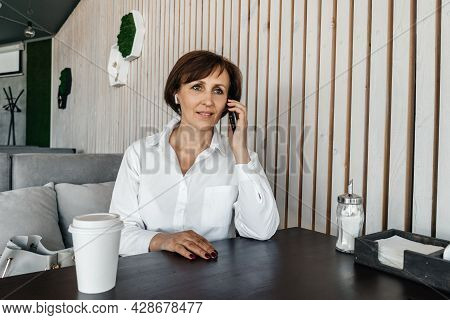 Senior Businesswoman Work In Cafe. Remote Work.