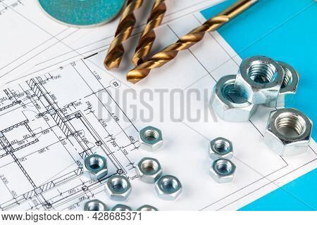 Nuts And Parts Of The Construction Are Laid Out In A Dented Drawing