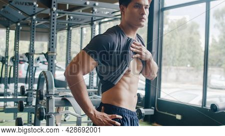 Handsome Asian Guy Take Out Shirt Naked Torso Body Look At His Muscles And Trained Body At Mirror In