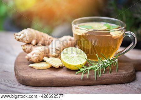 Ginger And Lemon Fresh Cocktail, Hot Ginger Juice In Glass And Mint With Slices Ginger Root Herbal J