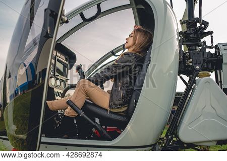 Dreamy Preteen Girl Sitting On Pilot Seat In Helicopter Cockpit