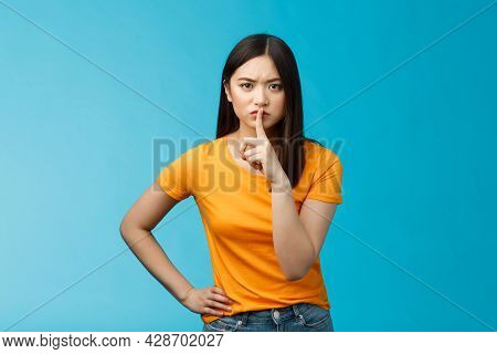 Hush Keep Quiet, Behave Well. Serious-looking Strict Asian Elder Sister Shushing Bending Towards Cam