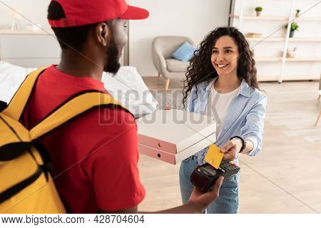 Deliveryman Holding Pos Machine, Satisfied Client Paying With Card