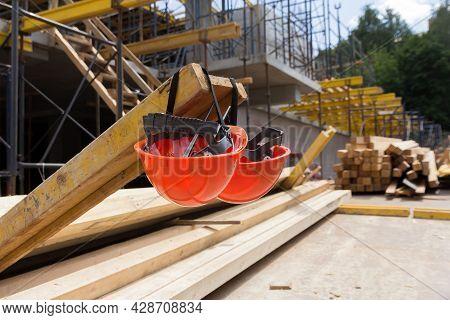 Construction Helmets At A Construction Site. Construction Helmet For Head Protection. Overalls. Helm
