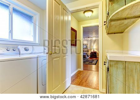Laundry Room With Open Door To Bedroom.