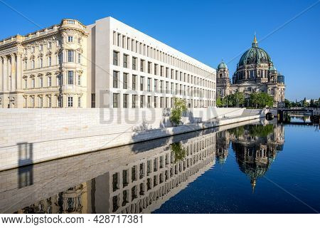 The Berliner Dom With The Reconstructed City Palace Reflected In The River Spree Early In The Mornin