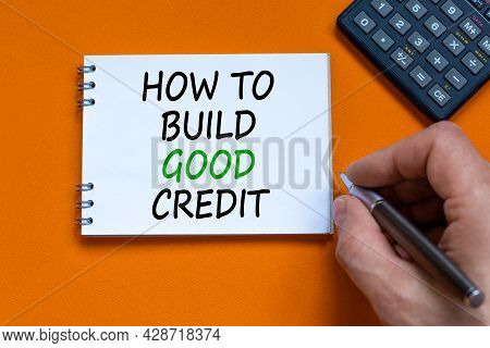 Symbol Of Building Success Foundation. Businessman Writing Words 'how To Build Good Credit' On White