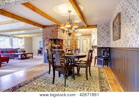 Dining Room Near Brick Fireplace And Living Room.